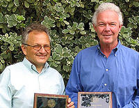 Norm Ellstrand and Emory Elliott, with their awards