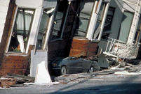 An automobile lies crushed under the third story of a San Francisco apartment building after the 1989 Loma Prieta earthquake.