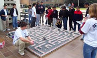 Students watch as a robot makes its way through a maze.