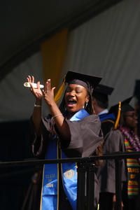 Erin Small celebrates at last year's commencement ceremony (photo by Carlos Puma)
