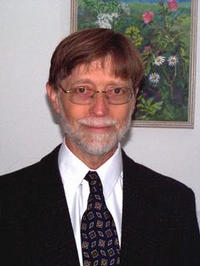 Allen Mills, leader of the research project on the collision of positronium atoms, is a professor of physics at UCR.
