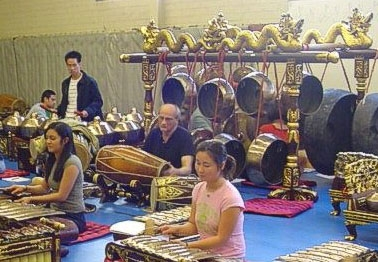 Professor Lysloff (center) practices with students on the new gamelan, a set of predominantly percussive instruments featuring tuned bronze gongs, bronze-keyed instruments, and drums from Central Java.