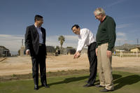 President Chen Zhangliang of China Agricultural University tests out the turfgrass research at UC Riverside. <br />