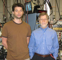 David Cassidy (left) is an assistant researcher working with Allen Mills (right), a professor of physics at UCR.  Photo courtesy of D. Cassidy, UCR.