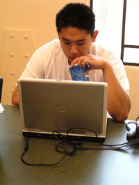 Kevin Huynh sips a soda in a study room at the Rivera Library.