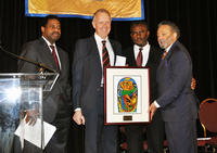 Craig Byus, dean of the UCR biomedical sciences division, second from left, received a Freedom Fund Award from the NAACP-Riverside branch. Presenting the honor were, from left, A.J. Rogers, president of the J.W. Vines Medical Society, E.M. Abdulmumin of the NAACP-Riverside Branch, and Ernest Levister, clinical professor of medicine at UC Irvine. (photo by Kathy Barton)