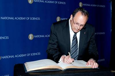 Alexander Raikhel, a distinguished professor of entomology at UC Riverside, signs the Great Book of the National Academy of Sciences (NAS) at the NAS induction ceremony, April 24, 2010. Photo credit: NAS.