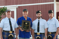 From left, Pipe Major Mike Terry, musical instructor Ian Whitelaw, piper Erik Ragsdale, and drummer William Terry display the first-place award the UCR Pipe Band won for timed medley march on May 24 in Costa Mesa.