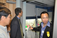 Chee Duncan Gee Liew (right), the academic coordinator of UCR's Stem Cell Core Facility, gives a tour of the facility to visitors at the grand opening, Jan. 29.  Photo credit: UCR Strategic Communications Office. (More photos below.)