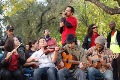 UCR staff member Mike Atienza sings with a performing group called
