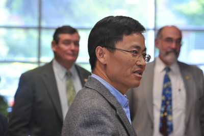 Jian-Kang Zhu speaks at a reception held in his honor at UC Riverside, April 27, 2010.  In the background are Chancellor Timothy White (left) and Dean Thomas Baldwin (right).  Photo credit: UCR Strategic Communications.