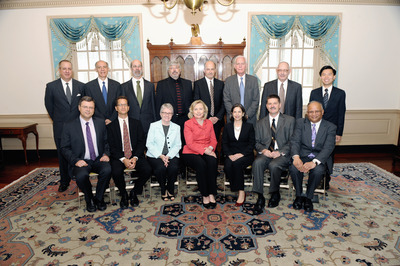 Photo, taken July 6, 2011, shows the 2010-2011 Jefferson Science Fellows with the Secretary of State.  Thomas Miller, the first entomologist to be a Jefferson Science Fellow, is seen standing, second from the right.  Photo credit: U.S. Department of State.