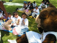 Kindergarten students enjoy a visit from Scotty the Bear.