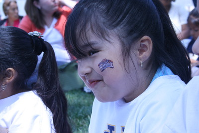 A student displays her temporary UCR tattoo.