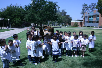 Students pose with Scotty the Bear.