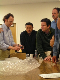 In a past Summer Physics Academy at UC Riverside, John Ellison (left), a professor of physics, helps local high-school teachers build a cosmic ray detector.  Photo credit: UCR Strategic Communications.