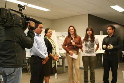 From left to right, David Becerra, a student, Melba Castro, director of the first-year student success program, and students Erica Aragon and Xorge Alanis, are interviewed by Cecilia Bogran, center, a reporter from Univision 34 Los Angeles KMEX.