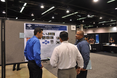 A student (left) discusses his research with Victor Rodgers (right), a professor of bioengineering at UCR and a judge at SACNAS.  Photo credit: UCR Strategic Communications.
