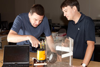 Eamonn Keogh, left, and Gustavo Batista demonstrate a sensor they built that they believe could help fight malaria.