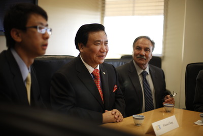 Chinese inventor and businessman Winston Chung with Reza Abbaschian, dean of the Bourns College of Engineering, looking on.