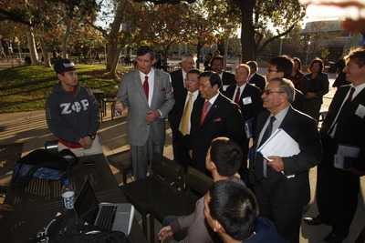 UC Riverside Chancellor Timothy B. White and Chinese inventor and businessman Winston Chung talk with students on campus.
