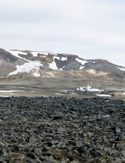 The Iceland Drilling Company rig at the Krafla geothermal field, in northern Iceland,  that drilled into 900°C rhyolite magma at 2140 meters depth in June 2009, viewed across  a basalt flow from the 1974-85 eruption. Photo credit: W. Elders, UC Riverside.