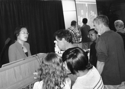 Jeanie Lau, an associate professor of physics and astronomy, talks to audience members after her presentation, May 19. Photo credit: S. Clausen, UC Riverside.