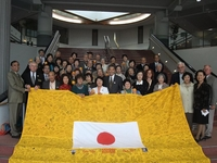 Officials from Riverside and Sendai display a banner signed by hundreds on the UC Riverside campus following the earthquake and tsunami in Japan.