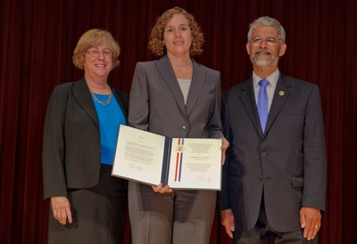 Elizabeth Cochran (center) accepts the Presidential Early Career Award for Scientists and Engineers on Friday in Washington, alongside the president's science and technology adviser, Dr. John P. Holdren, and Dr. Joan Ferrini-Mundy, assistant director for education and human resources at the National Science Foundation. Photo credit: NASA/Paul E. Alers.