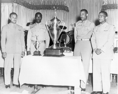 Top Gun team members, shown in this 1949 photo with their trophy, are (from left) 1st Lt. Halbert Alexander, 1st Lt. James Harvey, Capt. Alva Temple and 1st Lt. Harry Stewart.<br />
