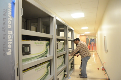 A 40-foot-long array of batteries being installed in Winston Chung Hall.