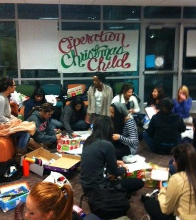 Members of UCR sororities participate in the creation of gift boxes as part of Operation Christmas Child. The boxes will be shipped throughout the world. (Photo courtesy of Grace Castruita.)