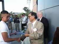 Bourns College of Engineering Dean Satish Tripathi congratulating a CSEMS Scholar.