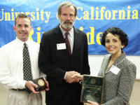 Aaron Bushong, Bob Gill and Chancellor France A. Cordova celebrate Gill's selection as 2003 Outstanding Staff