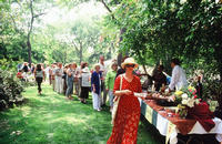 Guests sample food and wine at Primavera in the Garden, 2003.<br />