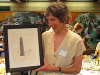 Mary Lee Reynolds shows off a carillon print by UCR alumna Judy Field-Baker
