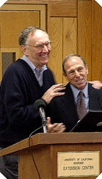 Jack Dangermond, left, accepts gift from Jack Azzaretto. Photo by Clyde Miller